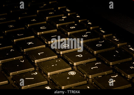 Computer Keyboard Closeup While Key Are Being Pushed - Stock Photo
