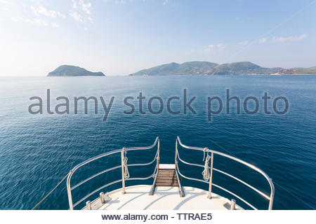 Cropped image of sailboat sailing in sea against sky - Stock Photo