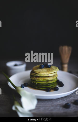 Close-up of matcha pancakes served in plate on table - Stock Photo