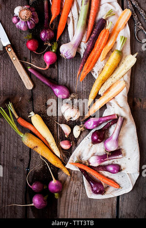 High angle view of various vegetables on wooden table - Stock Photo