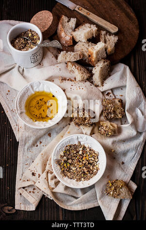 High angle view of various ingredients on messy table - Stock Photo