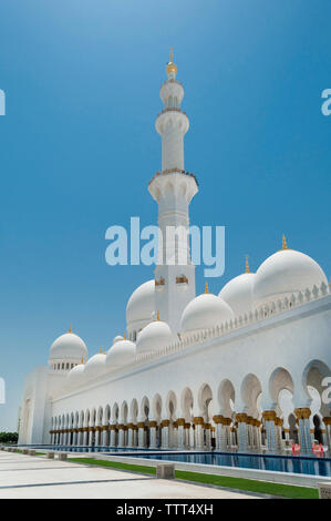 Sheikh Zayed Mosque against clear blue sky during sunny day - Stock Photo