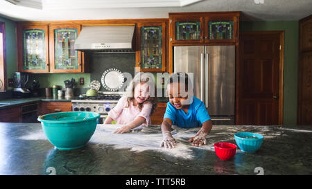 Kids making a mess in the kitchen - Stock Photo