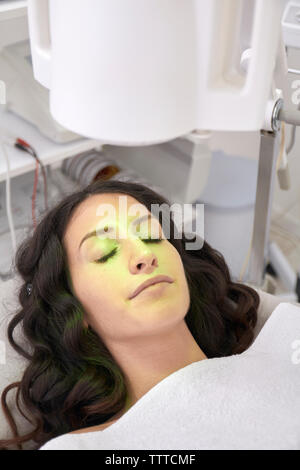 High angle view of patient having light therapy in medical clinic - Stock Photo