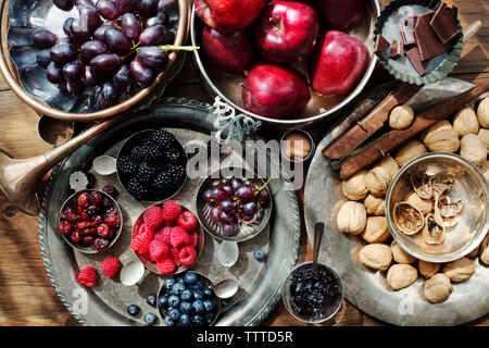 Overhead view of fruits and nuts on table - Stock Photo