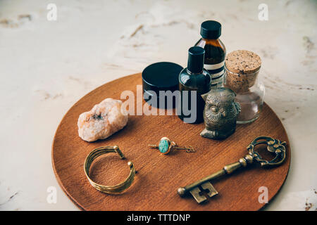 High angle view of objects arranged on wooden board - Stock Photo