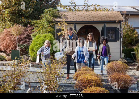 Students with teacher in plant nursery during field trip