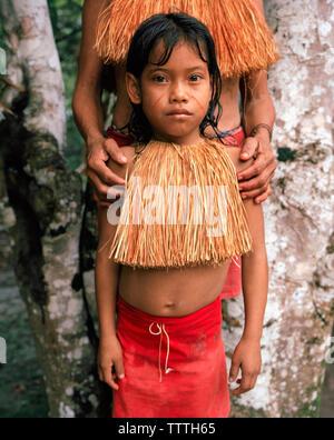 PERU, Amazon Rainforest, South America, Latin America, portrait of a Yagua Indian girl in traditional clothing - Stock Photo