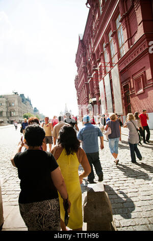 RUSSIA, Moscow. Tourist and locals walking into Red Sqaure. - Stock Photo