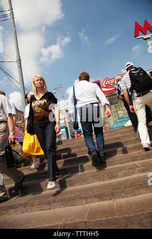 RUSSIA, Moscow. Crowd leaving and going into a Metro Station in the city center. - Stock Photo