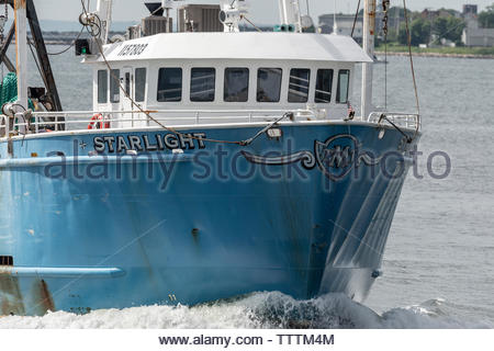 New Bedford, Massachusetts, USA - June 17, 2019: Commercial fishing vessel Starlight returning to New Bedford - Stock Photo
