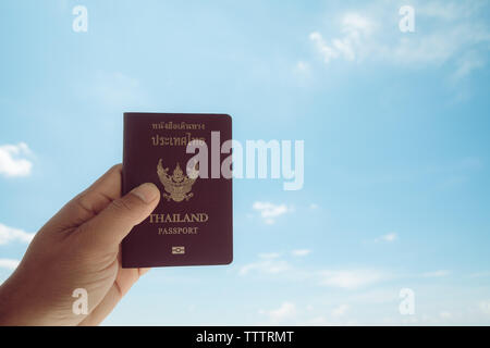 Passport in Thailand, isolated on the sky background - Stock Photo