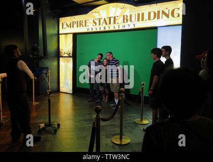 Empire State Building New York City, NY USA. Jul 2017. Tourists having their photos taken by an official photographer. - Stock Photo