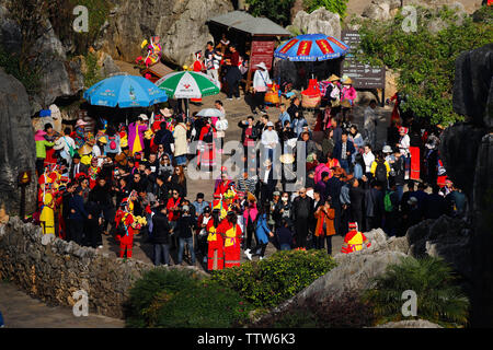 Crowd of people visiting the Stone Forest in Yunnan. Yunnan, China - November, 2018 - Stock Photo