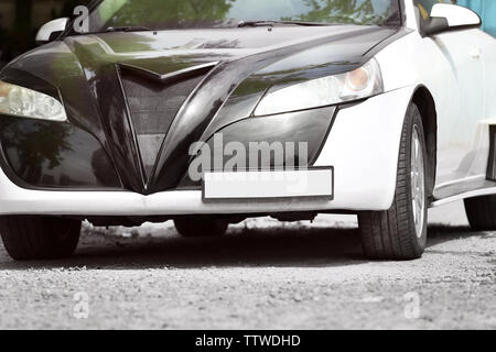 Car parked on the street - Stock Photo