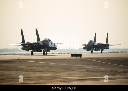 Two F-15E Strike Eagles from the 336th Fighter Squadron, 4th Fighter Wing at Seymour Johnson Air Force Base, North Carolina taxi the runway at Al Dhafra Air Base, United Arab Emirates, June 13, 2019. The F-15E's joined ADABs inventory of other fighters to include F-15C Eagles and F-35A Lightning IIs. (U.S. Air Force photo by Staff Sgt. Chris Thornbury) - Stock Photo