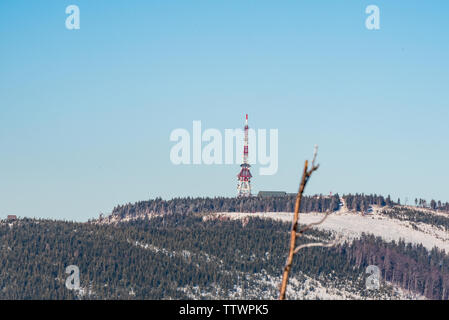 Skrzyczne hill with hut and communication tower from rock formation on Malinowska Skala hill in winter Beskid Slaski mountains in Poland - Stock Photo