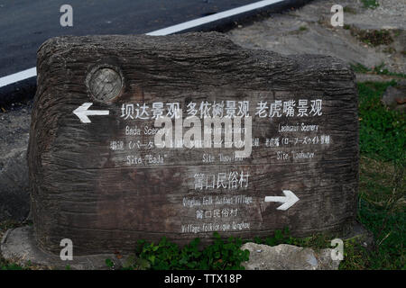 Tourist signpost. Rice terraces of Yunnan, China. The famous terraced rice fields of Yuanyang in Yunnan province in China - Stock Photo