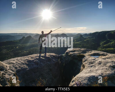 Man with crutches and strong will. Disabled tourist successfully climb  in park. Hiker man is celebrate alone attachment of his target. - Stock Photo