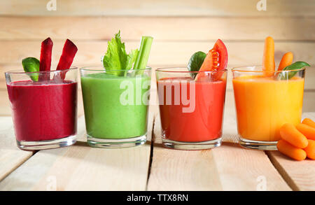 Glasses with fresh vegetable smoothie on wooden table - Stock Photo