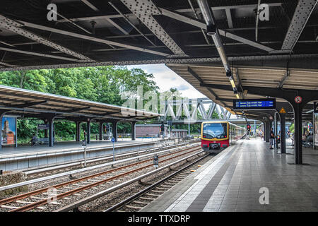 Berlin Westkreuz S-Bahn Railway station with people waiting on platform. Sbahn station in the Charlottenburg district serves the S 3, S 41, S 42, S 46 - Stock Photo
