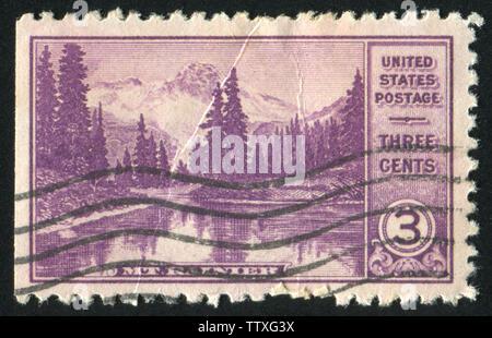 UNITED STATES - CIRCA 1934: stamp printed by United states, shows Mt. Rainier and Mirror Lake, circa 1934 - Stock Photo