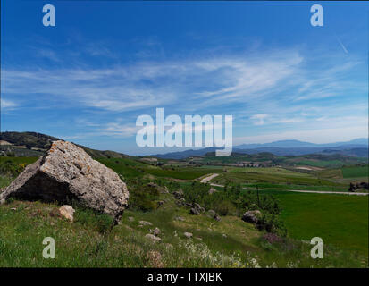 Looking south amongst the rolling hills and high mountains of the Andalucian region near to the Old City of Antequera in Spain on a fine May Day. - Stock Photo