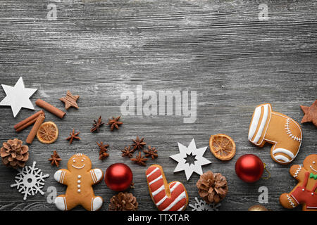 Composition of tasty cookies and Christmas decor on wooden table - Stock Photo