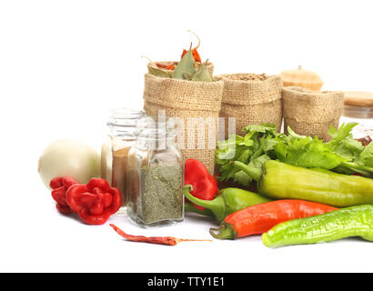 Spices in sacking bags on white background - Stock Photo