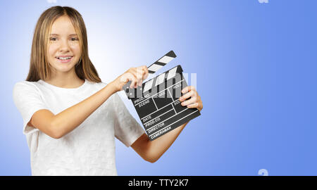 Little girl with a clapper board isolated - Stock Photo
