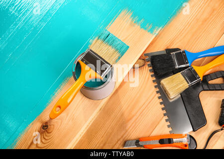 House renovation tools on turquoise painted wooden background - Stock Photo