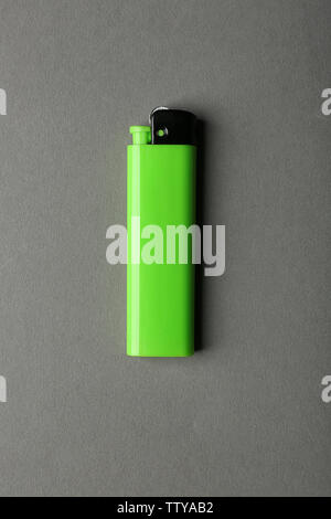 Blank green cigar lighter on grey background - Stock Photo