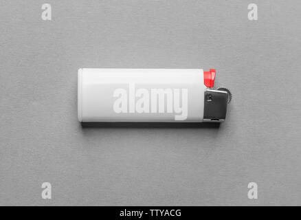Blank white cigar lighter on grey background - Stock Photo