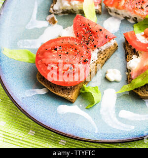 Brunch - wholemeal bread sandwich with tomato, cottage cheese and lettuce - Stock Photo