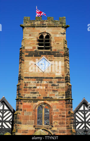 The 16th century church tower of St Oswald, in the village of Lower Peover, Cheshire, Northern England - Stock Photo