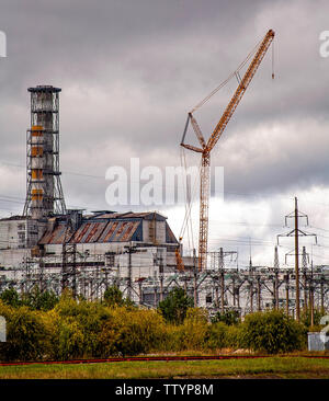 Reactor 4. The reactor that caught fire, causing the nuclear catastrophe of Chernobyl in 1986. This was one of 6 reactors in a row, fronting onto a man made lake, with the water suppiled from the Pripryat River. The number of direct and indirect deaths caused by this disaster has never been officially stated. There are still 2 exclusion zones over 30 years later. The area will never be the same again. Chernobyl is in the North of the Ukraine, close to the modern borders with Belarus and Russia. Sited as the single most important factor in bringing down the Berlin Wall. The costs were enormous. - Stock Photo