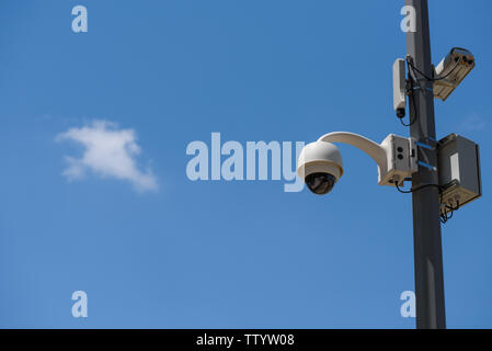 CCTV cameras mounted on the pole over sky copy space