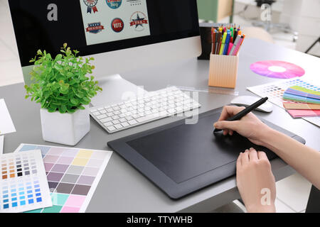 Young designer drawing sketches on graphic tablet, closeup - Stock Photo