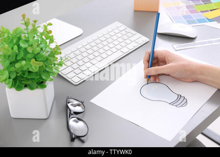 Young designer drawing sketch in office, closeup - Stock Photo