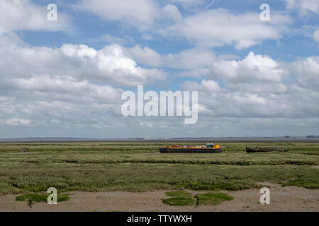 Barge and boats at Old Leigh, Essex, England, against a blue sky - Stock Photo