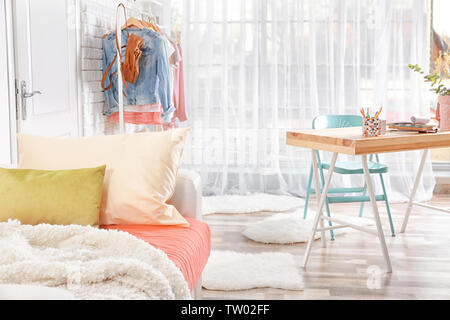 Interior of teenage girl's room with sofa - Stock Photo