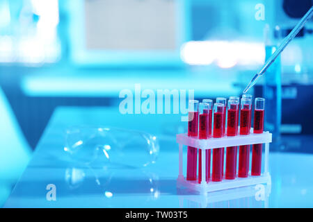 Test tubes with blood in laboratory on table - Stock Photo