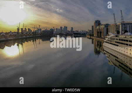 Royal Dock, London, UK - February 16. 2018: Tranquil shot taken at sunset of the Royal Dock and looking towards Canary Wharf.  Lovely still water and - Stock Photo