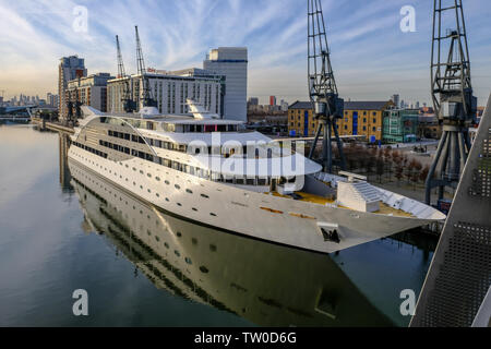 Royal Victoria Dock, London, uk - February 14, 2018: Sunborn Yacht hotel moored beside the dock with cranes and ibis hotel in the background. - Stock Photo