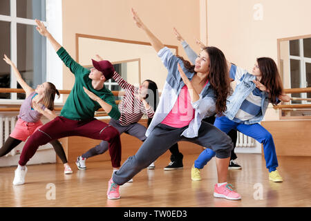 Group of young hip-hop dancers in studio - Stock Photo