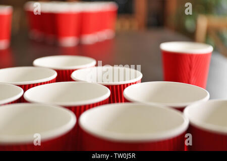 Cups for game Beer Pong on table, closeup - Stock Photo