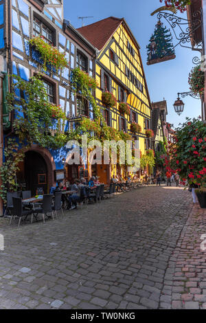 picturesque timbered houses overgrown with vine, Riquewihr, Alsace, France, historcial old village and touristy site - Stock Photo