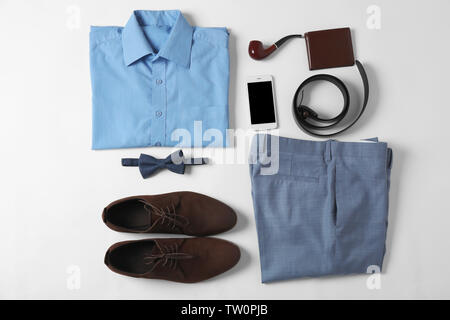Flat lay set of male clothes and accessories on white background - Stock Photo