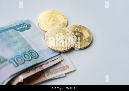 bitcoin gold and the Russian ruble. Bitcoin coin on the background of Russian rubles - Stock Photo