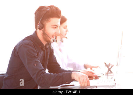 professional call center operators communicate with customers. telemarketing and communication services - Stock Photo